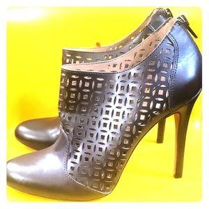 High heeled dark brown booties